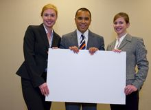 Team holding a blank sign Stock Photo
