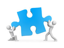 Team holding puzzle Stock Photos