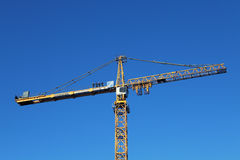 Team of installers stands on counterweight jib yellow tower cran Stock Photo