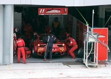 Team JimGainer Ferrari car 11 in pit stop Stock Photography
