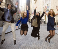 Team jump. Celebrating a victory, business team members jump for joy downtown stock images