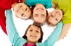 Team of kids. Team of happy kids embracing together Stock Images