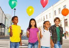 Team of kids with colorful balloons standing Stock Photography