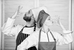 Team of kitchen. couple in love with perfect food. Menu planning. culinary cuisine. man and woman chef. secret royalty free stock image