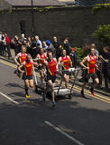 Team 1 in the knaresborough bed race 2015. Knaresborough bed race Royalty Free Stock Images
