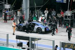 Team Kondo Nissan car 24 change a driver Royalty Free Stock Photos