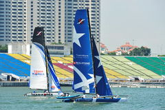 Team Korea racing Realteam at the Extreme Sailing Series Singapore 2013 Stock Photography