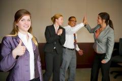 Team la celebrazione con la donna in priorità alta Immagine Stock Libera da Diritti