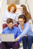 Team with laptop and tablet pc on staircase Royalty Free Stock Photography
