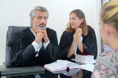 Team lawyers consulting client in office Stock Photography