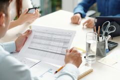 Free Team Leader Checking Document With Table Stock Photography - 213974632