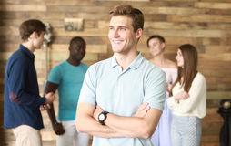 Team leader with coworkers working in office. Team leader with coworkers working in office Stock Images