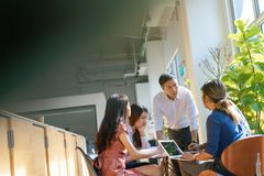Team leader meeting with young asian employees in smart casual wear.  royalty free stock image