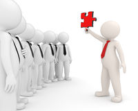 Team leader showing a puzzle - 3d people. 3d team leader showing a red puzzle piece to his people - Image on white background with soft shadows- Solutions Royalty Free Stock Images