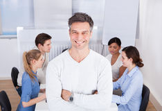 Team Leader Standing At Workplace Imagens de Stock