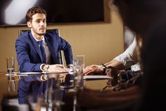 Team leader talking with coworkers in modern office. Business Team leader talking with coworkers in modern office Royalty Free Stock Image