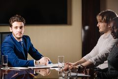 Team leader talking with coworkers in modern office. Business Team leader talking with coworkers in modern office Stock Photos