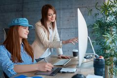 Team leader woman is consulting the employees and discussing the royalty free stock photography