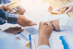 Team leaderof business man is pointing  financial results. Stock Images