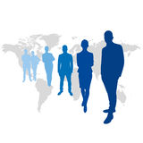 Team leaders  in front of world map Royalty Free Stock Image