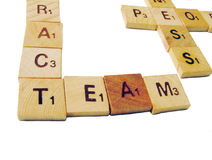 Team letters. Letters with team and contract words crossed. Letters pieces in wood Stock Image