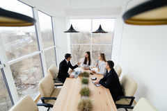 Team listen at meeting leader of project at conference table. Royalty Free Stock Photos