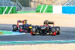 Team Lotus Renault F1, Romain Grosjean, 2012. JEREZ DE LA FRONTERA, SPAIN - FEB 10: Romain Grosjean of Lotus Renault F1 races followed by Vettel of Red Bull on Royalty Free Stock Photo
