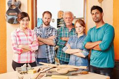Team of luthiers Stock Images