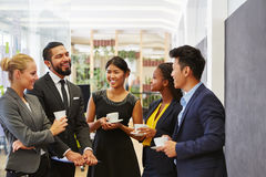 Team making small talk. In their coffee break Royalty Free Stock Images