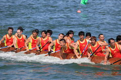 Team of male atheletes on dragonboat Royalty Free Stock Photography