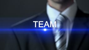 Team, male in business suit pressing buttons on screen, work spirit togetherness. Stock footage stock video