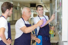 Team male workers cleaning Royalty Free Stock Photos