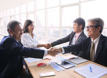 Team of man and woman business people successful shaking hand a stock photo