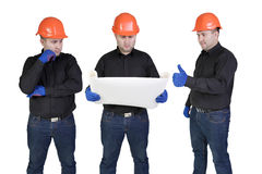Team manual workers. The command of builders in hands talks to the project on the isolated white background Royalty Free Stock Photo
