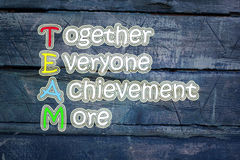 Team meaning written on blackboard background, high Stock Images