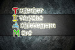 Team meaning written on blackboard background, high Royalty Free Stock Photos