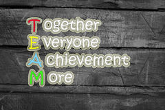Team meaning written on blackboard background, high Stock Photography
