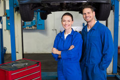 Team of mechanics smiling at camera Stock Photo