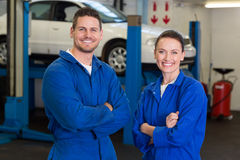 Team of mechanics smiling at camera Stock Photography
