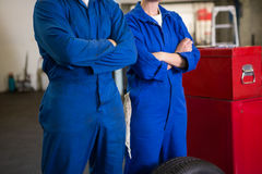 Team of mechanics standing with arms crossed Royalty Free Stock Image
