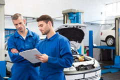 Team of mechanics talking together Royalty Free Stock Images