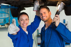 Team of mechanics working together Stock Image