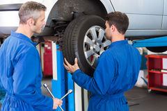 Team of mechanics working together Royalty Free Stock Photo