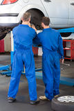 Team of mechanics working together Stock Photography