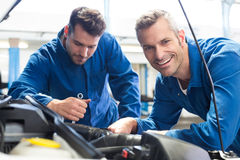Team of mechanics working together Royalty Free Stock Photos
