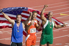 Team With Medals And American Flag Stock Photography