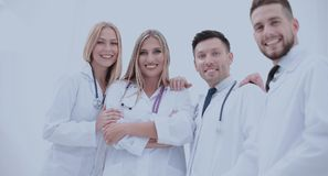 Team of medical professionals  looking at camera, smiling. Royalty Free Stock Image