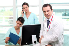 A team of medical professionals. At work royalty free stock photos