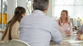 Team Meeting Around Table In Creative Office Stock Image