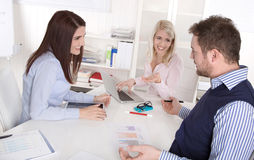 Team meeting with attractive businessman and two businesswomen. Royalty Free Stock Image